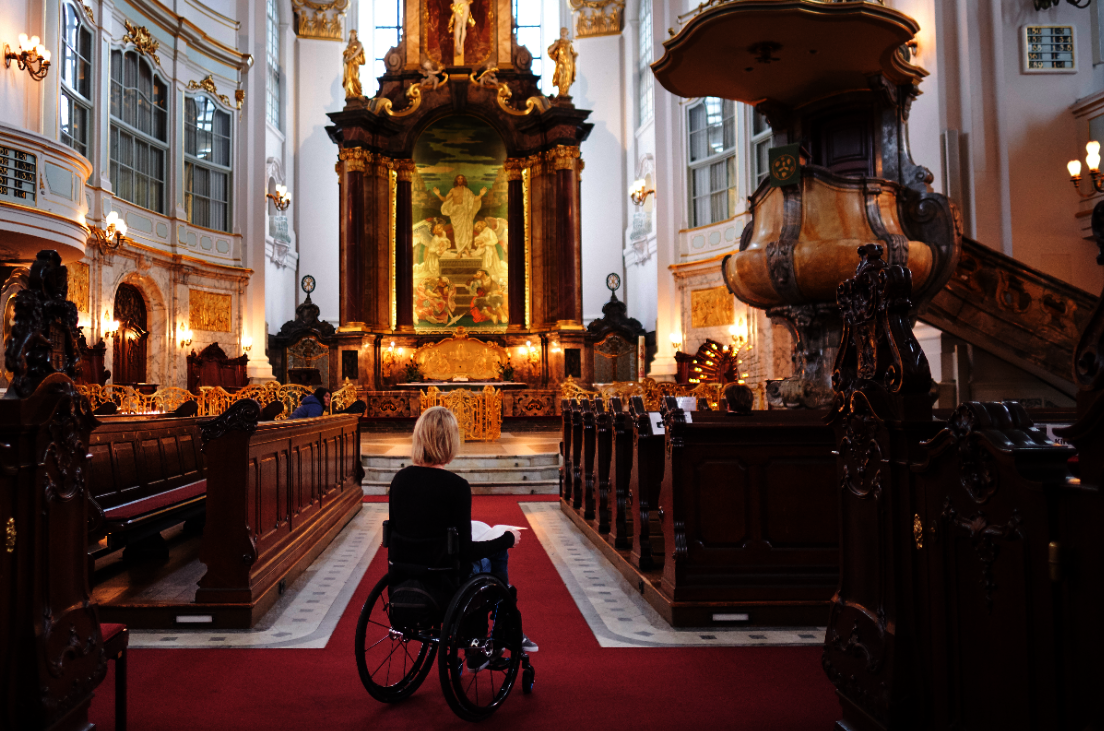 Woman in wheelchair in St Michael's church